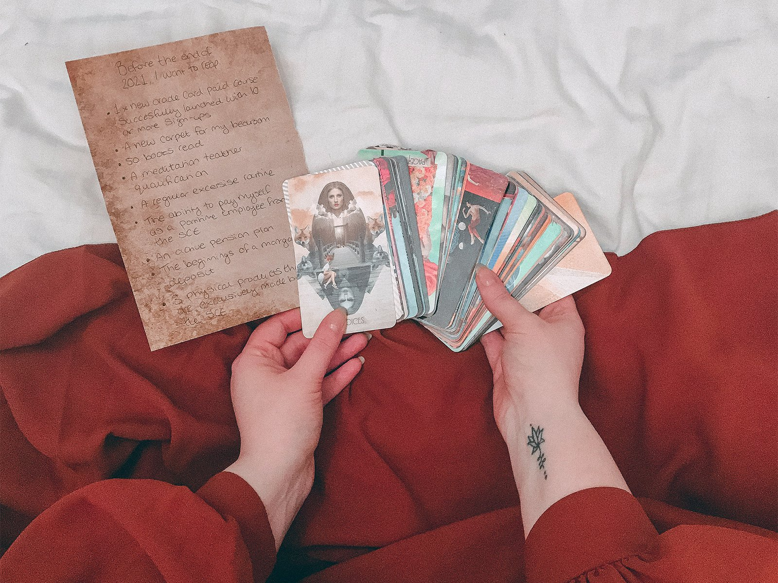 An individual uses tarot cards. Photo by Cat Crawford/Unsplash/Creative Commons