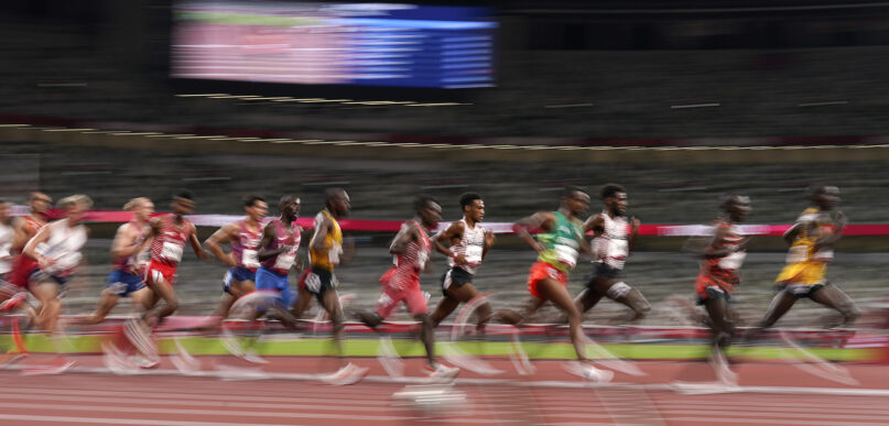 Jacob Kiplimo, of Uganda, right, leads the final of the men's 5,000-meters at the 2020 Summer Olympics, Friday, Aug. 6, 2021, in Tokyo, Japan. (AP Photo/Charlie Riedel)