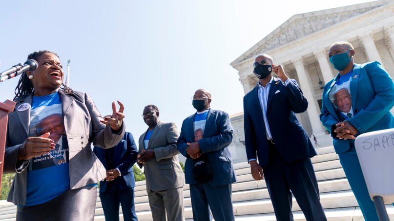 From left, Transformative Justice Coalition President and Founder Barbara Arnwine, accompanied by the brothers of the late Rep. John Lewis, D-Ga., Henry Lewis and Samuel Lewis, Democratic Texas State Rep. Ron Reynolds from Missouri City, and the niece of the late Rep. John Lewis, D-Ga., Angela Lewis Warren, speaks during a voting rights rally on the steps of the Supreme Court in Washington, Wednesday, Aug. 11, 2021. A year after his passing, the brothers and niece of the late Congressman John Lewis join Barbara Arnwine with the Transformative Justice Coalition and others to demand Congress and President Joe Biden do whatever it takes to pass the For the People Act and the John R. Lewis Voting Rights Act. (AP Photo/Andrew Harnik)