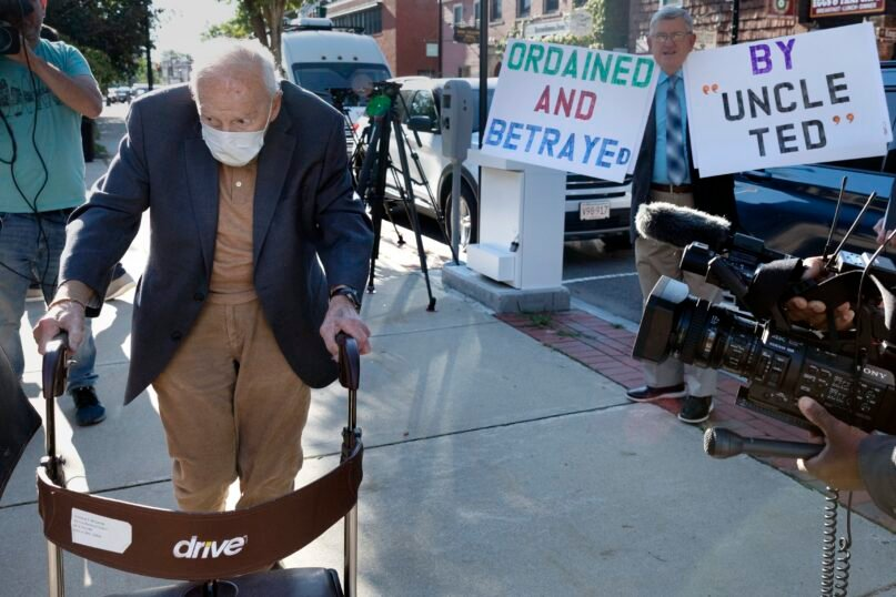 Former Cardinal Theodore McCarrick, left, arrives at Dedham District Court, Friday, Sept. 3, 2021, in Dedham, Mass.  McCarrick, the once-powerful American prelate who was expelled from the priesthood for sexual abuse, pleaded not guilty Friday to sexually assaulting a 16-year-old boy during a wedding reception in Massachusetts nearly 50 years ago.   (AP Photo/Michael Dwyer)