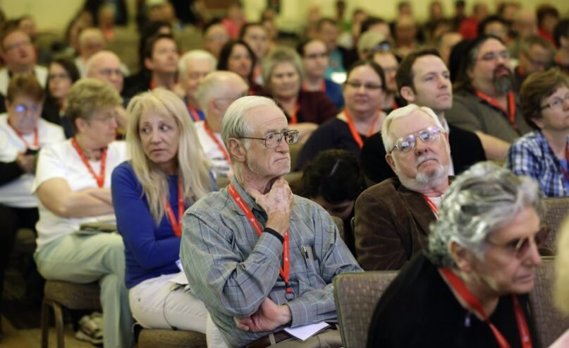 People in attend a talk at the American Atheists National Convention in 2014. Many Americans remain distrustful of atheists, surveys show. (AP Photo/Rick Bowmer)