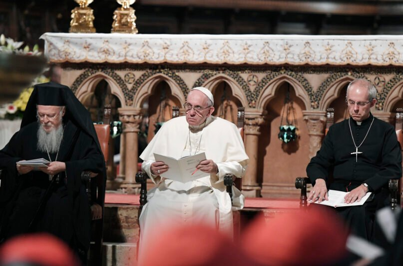 FILE - In this file photo, Pope Francis, center, flanked by Orthodox Patriarch of Constantinople Bartholomew I, left, and Canterbury Archbishop Justin Welby, pray together inside the Basilica of St. Francis, in Assisi, Italy. (Tiziana Fabi/Pool Photo via AP)