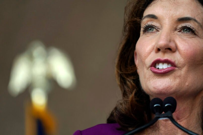 FILE - In this Thursday Aug. 26, 2021, file photo, New York Gov. Kathy Hochul speaks at an event in the Harlem section of New York. Gov. Hochul vowed to fight a lawsuit launched by a group of Christian health care practitioners who argue that New York's vaccine mandate is unconstitutional because it lacks a religious exemption. (AP Photo/Mary Altaffer, File)
