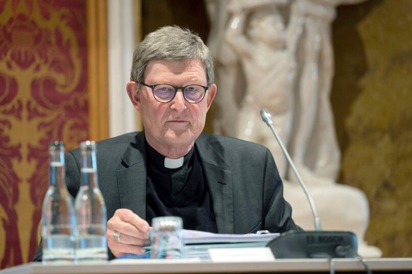 In this Sept.20, 2021 file photo Rainer Maria Cardinal Woelki, Archbishop of Cologne, sits in his seat at the beginning of the Autumn Plenary Assembly of the German Bishops' Conference in Fulda, Germany. (Sebastian Gollnow/dpa via AP, File)