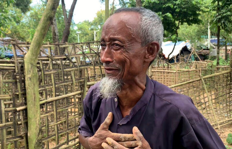 Sayed Alam, uncle of Mohibullah, an international representative of ethnic Rohingya refugees, cries after preparing a grave for his nephew at the Rohingya refugee camp in Kutupalong, Bangladesh, Thursday, Sept. 30, 2021. Mohibullah, who was in his 40s, was a teacher who emerged as a key refugee leader and a spokesman representing the Muslim ethnic group in international meetings, was shot to death in a camp in Bangladesh by unknown gunmen late Wednesday, police said. (AP Photo/ Shafiqur Rahman)