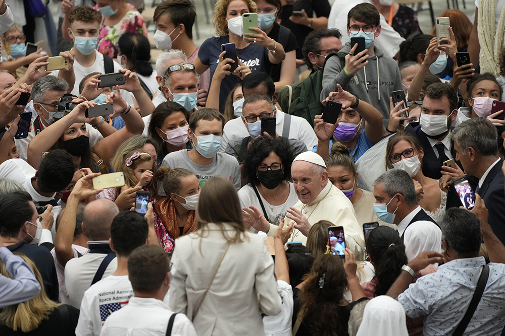 Pope Francis stops to greet the faithful as he leaves after his weekly general audience at the Vatican, Wednesday, Aug. 25, 2021. (AP Photo/Gregorio Borgia)