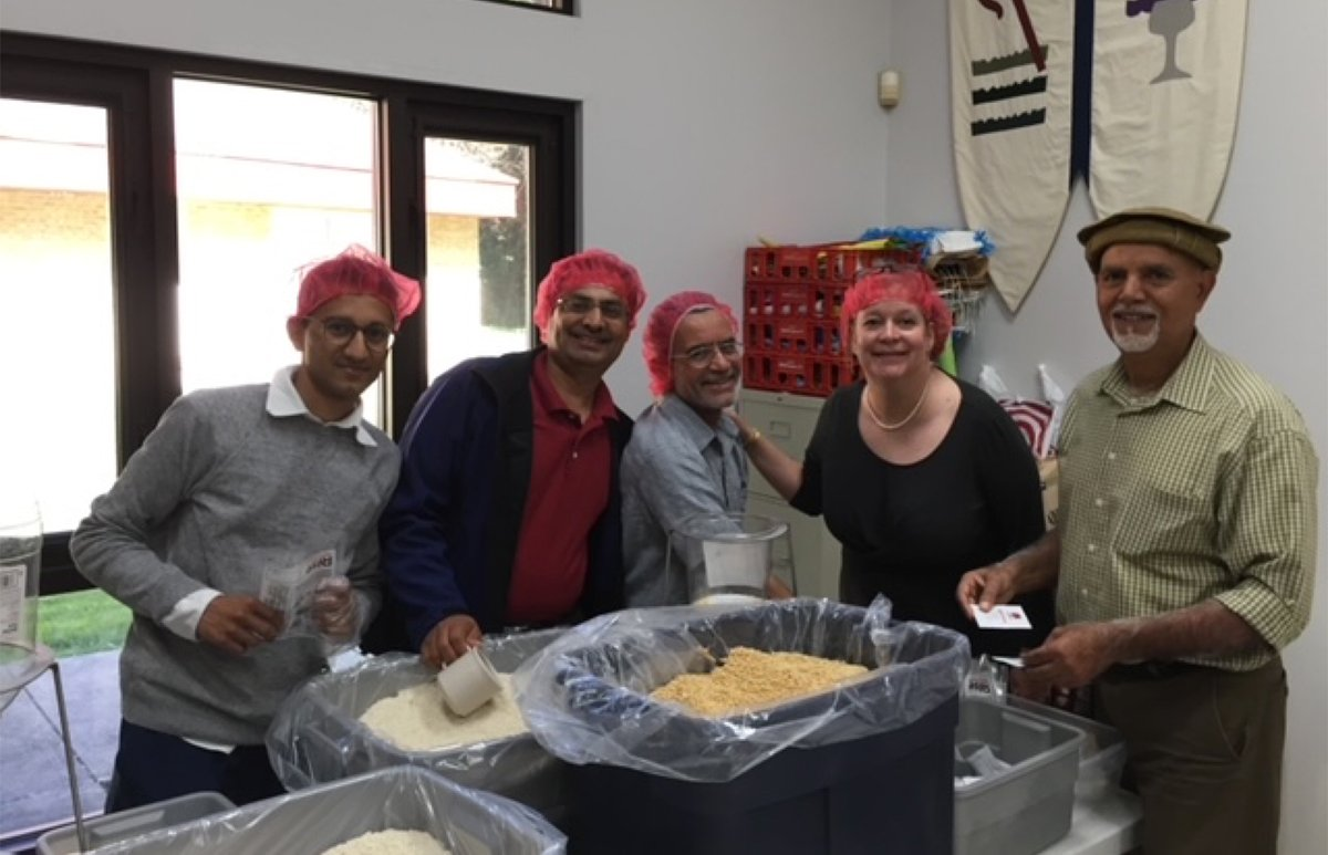 The Rev. Leslie Klingensmith, second from right, and several Ammadiyya Muslim friends participate in a Rise Against Hunger meal packing at St. Matthew Presbyterian Church in Silver Spring, Maryland. Courtesy photo