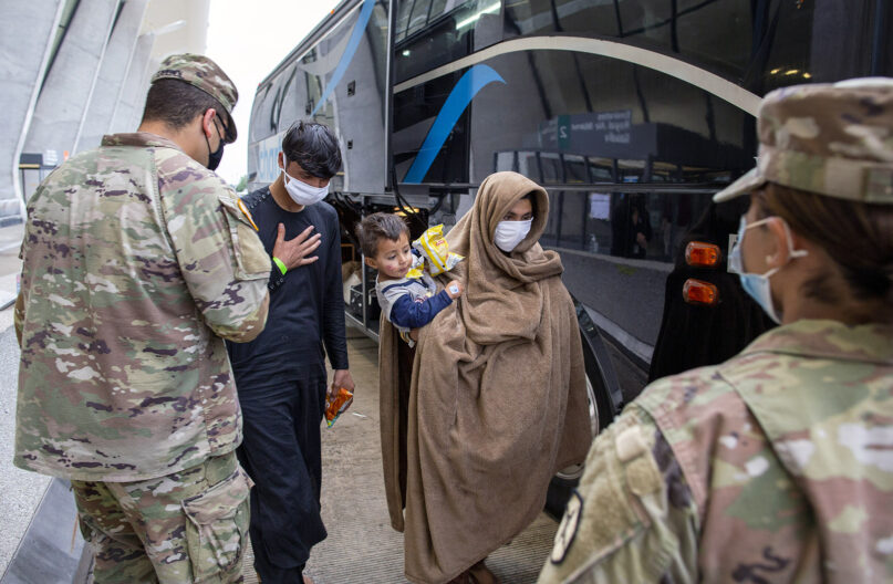 People evacuated from Kabul, Afghanistan, are greeted by U.S. service members at Washington Dulles International Airport, in Chantilly, Virginia, on Sept. 1, 2021. (AP Photo/Gemunu Amarasinghe)