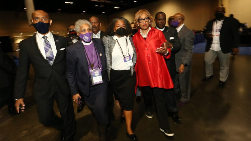 The Rev. Francine A. Brookins, center, walks with Bishop Anne Byfield, center left, and Bishop Vashti McKenzie, center right, to the stage after Brookins was elected during the African Methodist Episcopal Church conference in Orlando, Florida, in July 2021. Photo courtesy of the AME Church