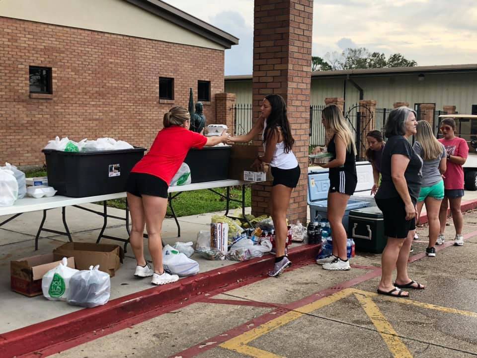 Volunteers distribute relief items from St. Joan of Arc Catholic Church in LaPlace, Louisiana, after Hurricane Ida. Photo courtesy of the Rev. David Ducote