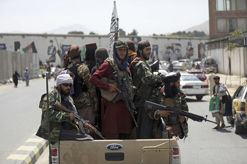 In this Aug. 19, 2021, file photo, Taliban fighters patrol in Kabul, Afghanistan. In the U.S. departure from Afghanistan, China has seen the realization of long-held hopes for a reduction of the influence of a geopolitical rival in what it considers its backyard. Yet, it is also deeply concerned that the very withdrawal could bring instability to that backyard — Central Asia — and possibly even spill over the border into China itself in its heavily Muslim northwestern region of Xinjiang. (AP Photo/Rahmat Gul, File)