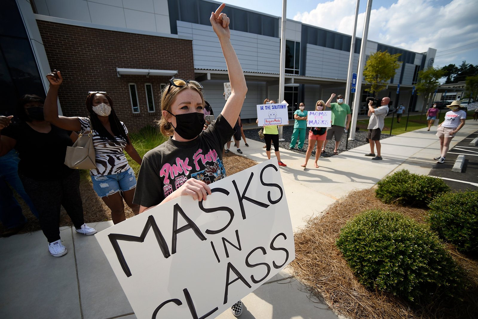Pro-mask wearing demonstrators stage a protest at the Cobb County School Board Headquarters, Thursday, Aug. 12, 2021, in Marietta, Ga. Many school districts nationwide have seen parents protesting for and against masks. (AP Photo/Mike Stewart)
