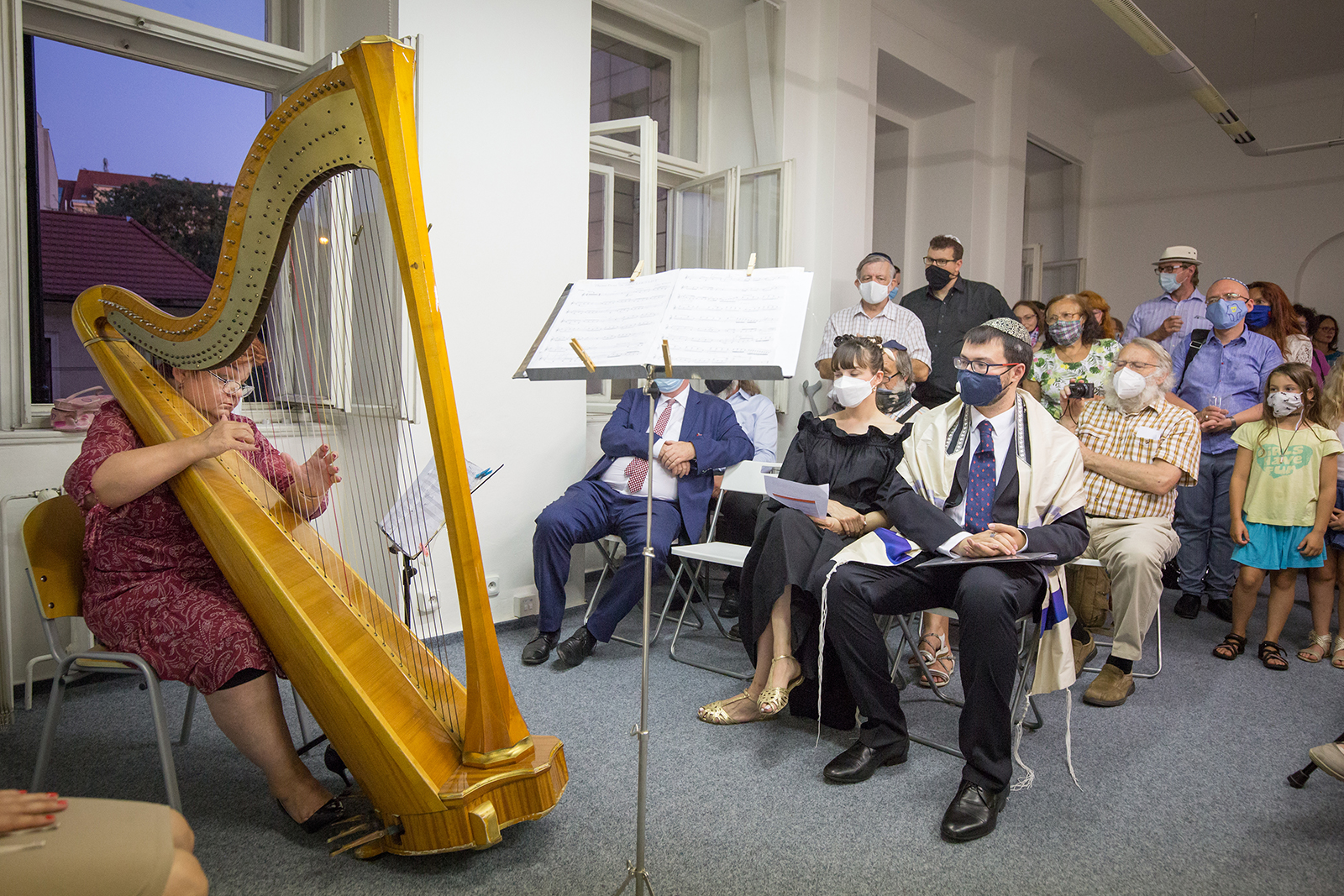 """A musician plays the hard during the opening of the """"Ec Chajim"""" synagogue in Prague, Czech Republic. Courtesy photo of Leona Kalvodová"""