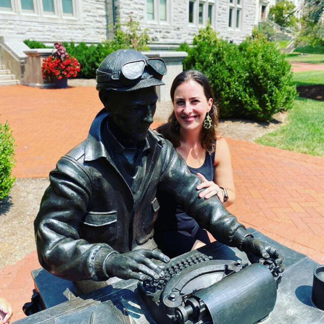 Dana Trent poses with a statue while visiting her home town of Dana, Indiana. Photo courtesy of Trent