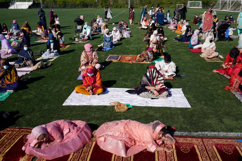 Females relax before the start of Eid al-Fitr prayers in Overpeck County Park in Ridgefield Park, N.J., Thursday, May 13, 2021. (AP Photo/Seth Wenig)