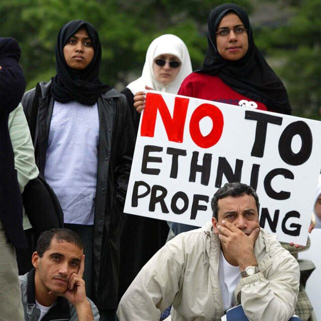 Palestinian Americans from Frederick, Maryland, listen to speakers at a May 2003 civil rights rally in Washington, D.C. The sign reads