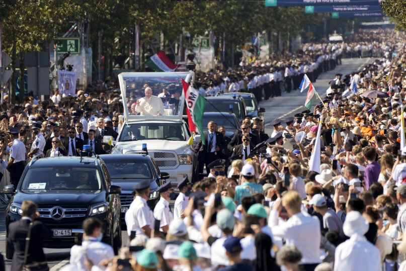 Pope Francis arrives on his popemobile to celebrate Mass for the closing of the International Eucharistic Congress, at Budapest's Heroes Square, Sunday, Sept. 12, 2021. (AP Photo/Gregorio Borgi41