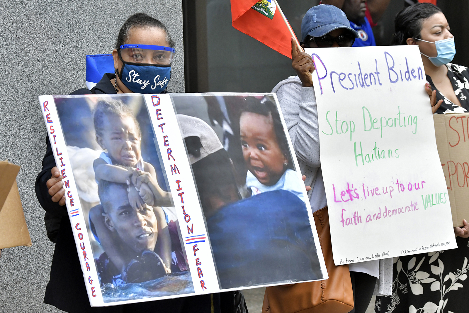 Haitian-Americans, including Clare Raymond of Boston, left, during a demonstration at the JFK Federal Building in Boston on Friday, Sept. 24, 2021. Members of Boston's sizable Haitian community staged a protest outside the Federal building to denounce the mistreatment of Haitian migrants at the border with Mexico. (AP Photo/Josh Reynolds)