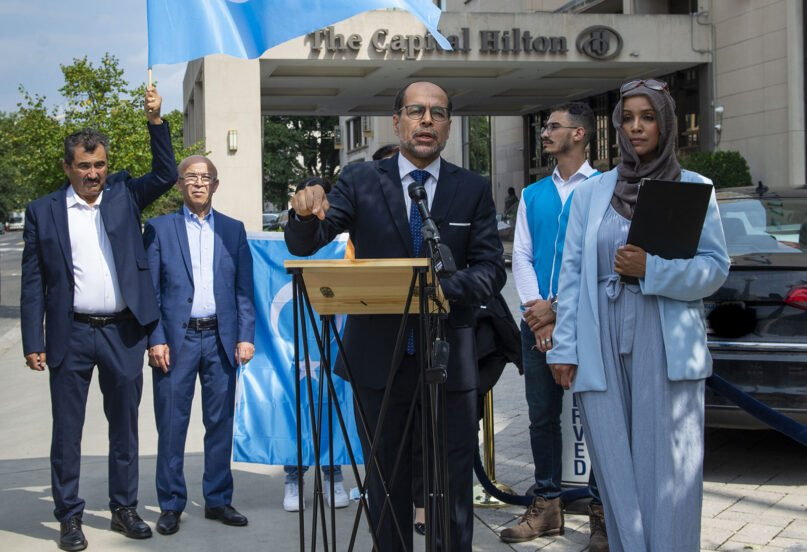 Nihad Awad, executive director of the Council on American-Islamic Relations, center, and other CAIR representatives and Uyghur human rights organizations hold a news conference at the Capital Hilton in Washington, D.C., on Sept. 16, 2021, to announce their boycott of the hotel chain. Photo courtesy of CAIR