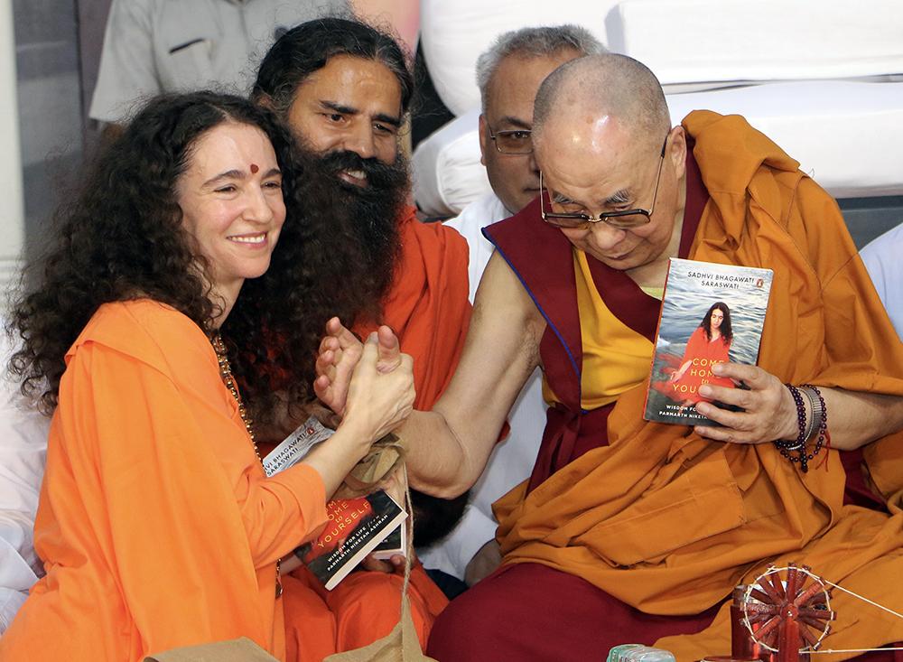 Sadhvi Bhagawati Saraswati, left, meets the Dalai Lama. Courtesy photo