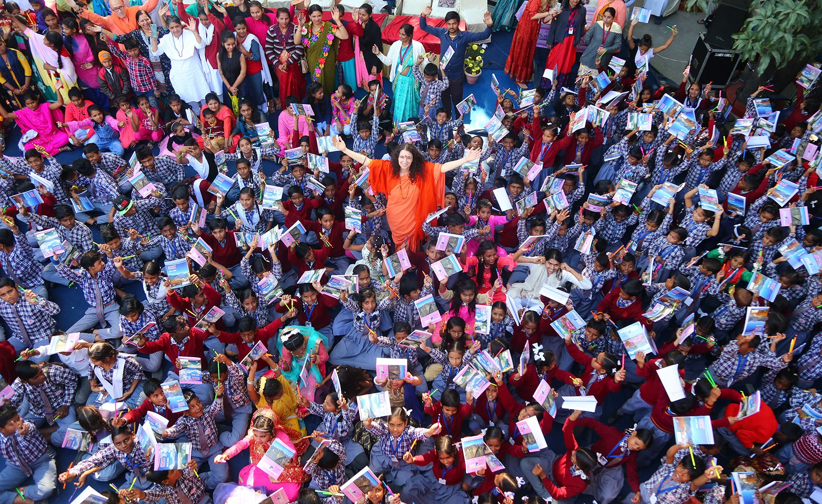 Sadhvi Bhagawati Saraswati, center, meets with children in India. Courtesy photo