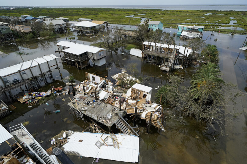 The remains of destroyed homes and businesses are seen in the aftermath of Hurricane Ida in Grand Isle, Louisiana, Aug. 31, 2021. (AP Photo/Gerald Herbert)