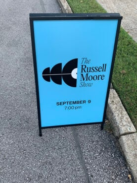 A sign for The Russell Moore Show podcast recording event with Bible teacher Beth Moore at Immanuel Church in Nashville, Thursday, Sept. 9, 2021. RNS photo by Bob Smietana