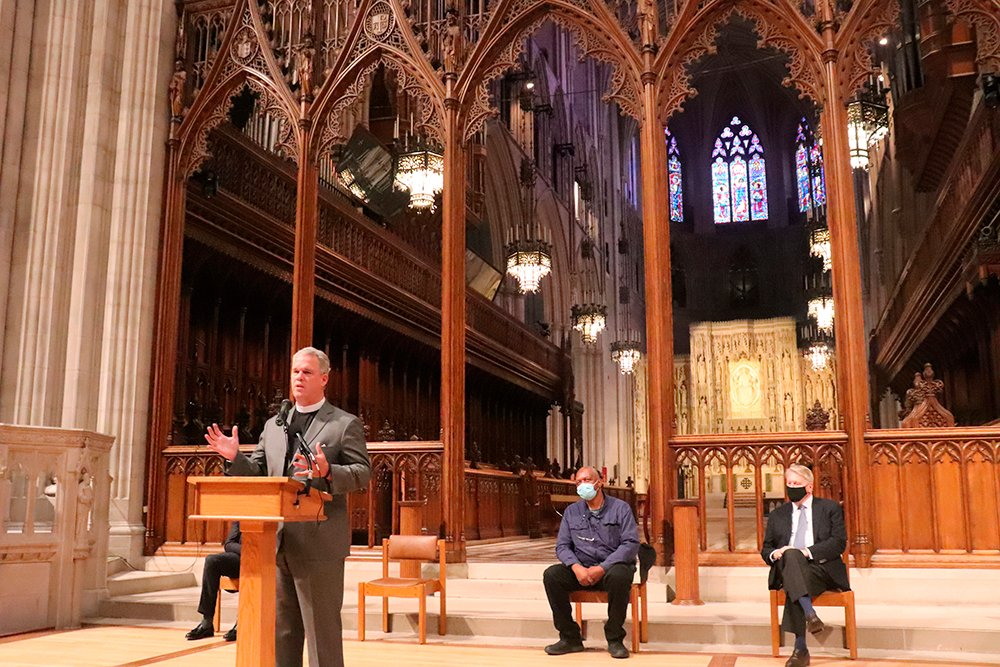 Washington National Cathedral's Dean Randy Hollerith announces plans to replace stained-glass windows that depicted Confederate generals at a news conference on Thursday, Sept. 23, 2021. Kerry James Marshall, center, is the artist two will design the windows and Chase Rynd, right, is co-chair of the windows replacement committee. RNS photo by Adelle M. Banks