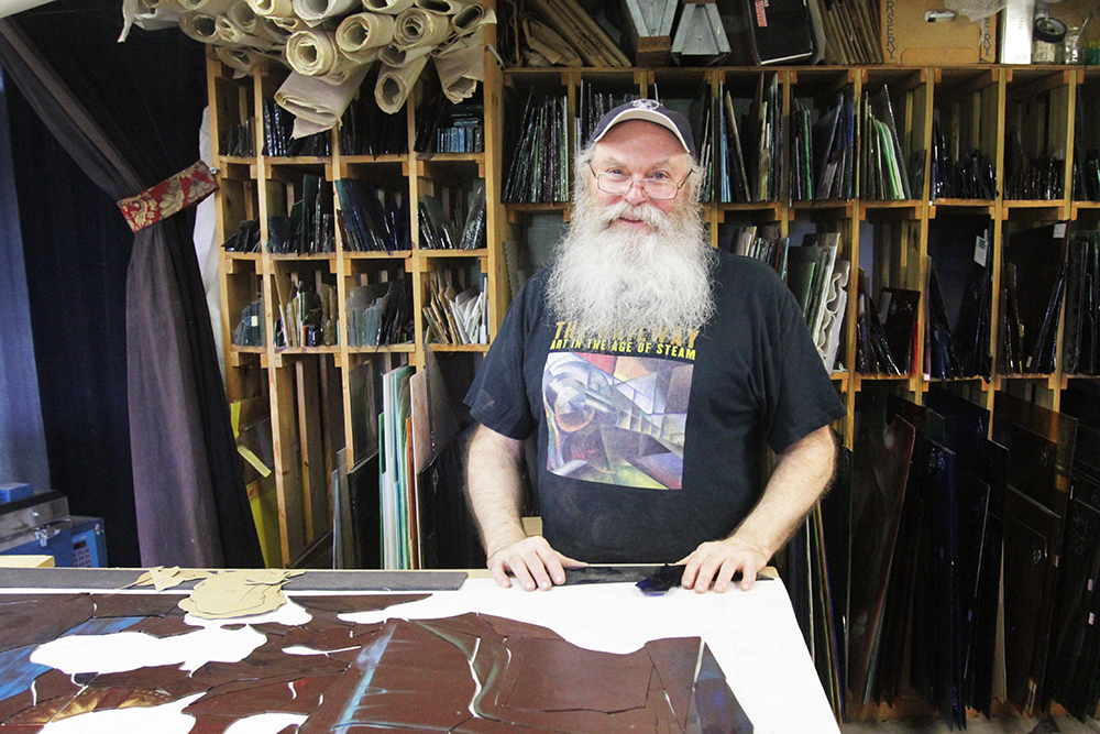 Stained glass artist Russell Joy poses at his studio near Kansas City, Missouri, on Friday, Aug. 20, 2021. RNS photo by Kit Doyle