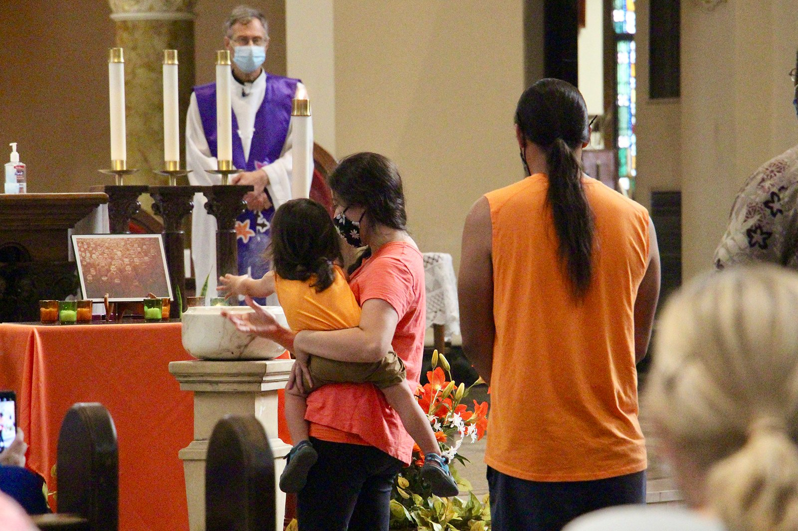 Attendees participate in a tobacco burning ceremony during the Prayer Service for Truth and Reconciliation, Sunday, Aug. 29, 2021, at St. Benedict Parish in Chicago. RNS photo by Emily McFarlan Miller
