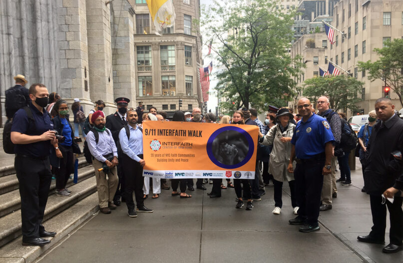Participants begin a prayer walk outside of St. Patrick's Cathedral, Thursday, Sept. 9, 2021, in New York. The prayer walk was sponsored by the Interfaith Center of New York City. RNS photo by Renée Roden