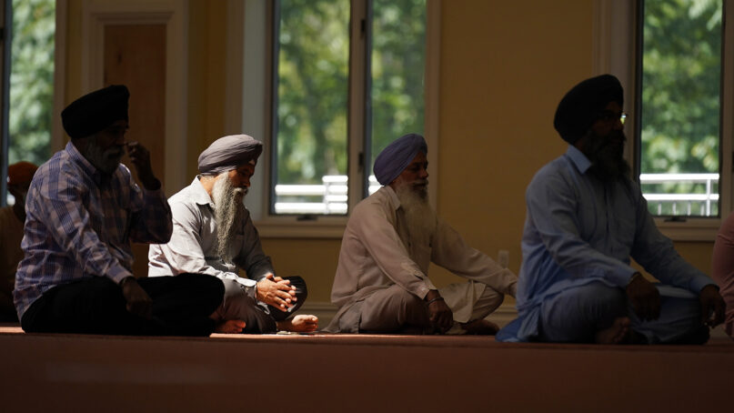 Sikhs participate in a worship service at a gurdwara in Glen Rock, New Jersey, on Aug. 15, 2021. (AP Photo/Seth Wenig)