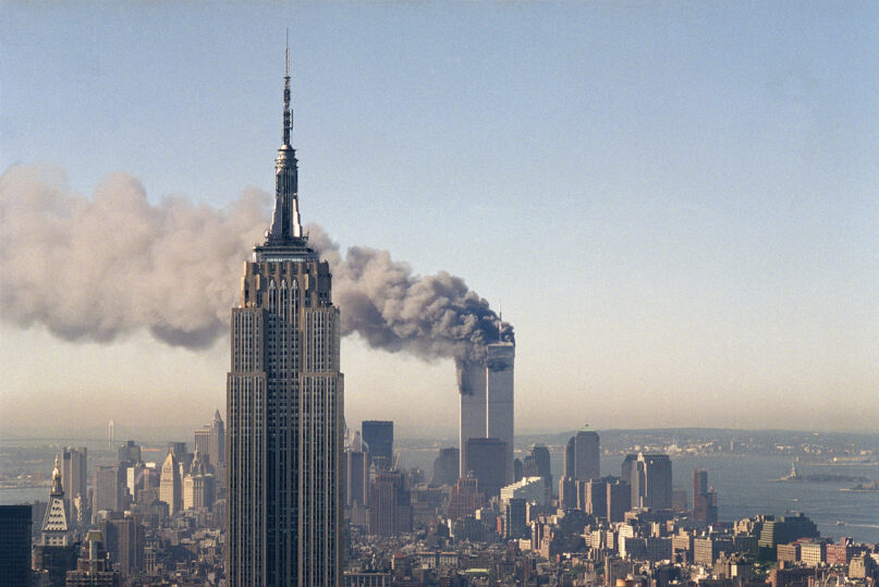 The twin towers of the World Trade Center burn behind the Empire State Building, Sept. 11, 2001, in New York. (AP Photo/Marty Lederhandler, File)