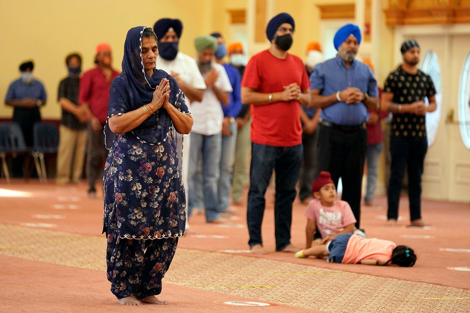 Sikhs participate in a worship service at a gurdwara in Glen Rock, N.J., Sunday, Aug. 15, 2021. (AP Photo/Seth Wenig)