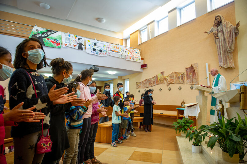 Residents attend a Mass inside a church located in the Roma settlement at the Lunik IX quarter of Slovakia's second-largest city of Kosice, Sunday, Sept. 5, 2021. Pope Francis will make his visit to the impoverished Roma community in Slovakia one of the highlights of his pilgrimage to