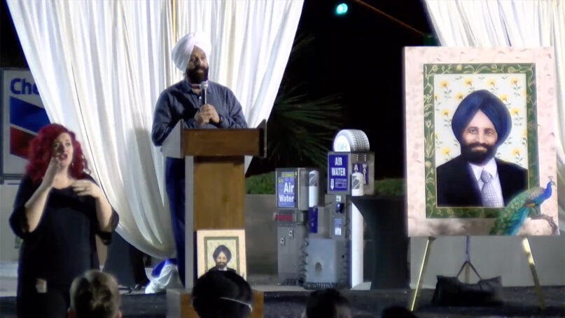 Rana Singh Sodhi, brother of Balbir Singh Sodhi, speaks to a crowd outside a Chevron station in Mesa, Arizona, during a memorial for Balbir Singh Sodhi on the 20th anniversary of his murder, Sept. 15, 2021. Video screen grab