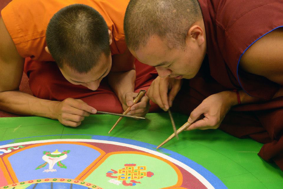Monks of the Tibetan Mongolian Buddhist Cultural Center in Bloomington, Indiana, work on a mandala in 2013. Coutesy photo