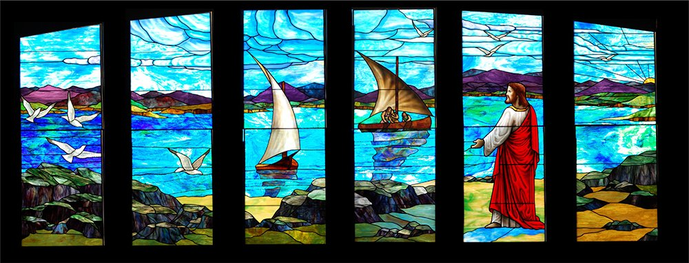A series of stained glass windows created by artist Russell Joy depict Jesus at the Sea of Galilee, at a church in San Francisco. Photo courtesy of Russell Joy