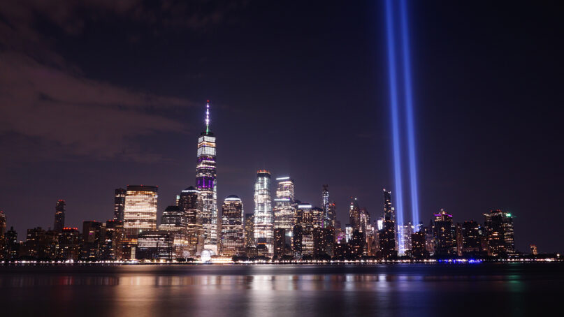 Tribute in Light, two vertical columns of light representing the fallen towers of the World Trade Center, shine against the lower Manhattan skyline. Photo by David Z/Pixabay/Creative Commons