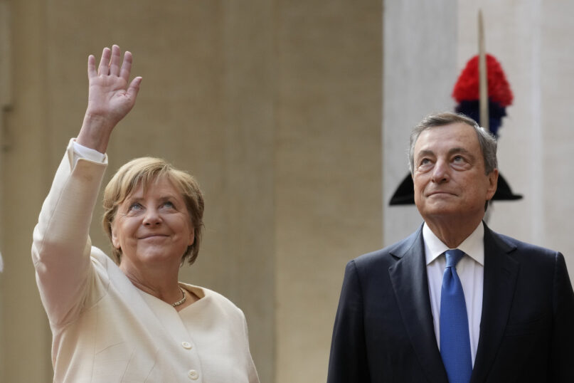 German Chancellor Angela Merkel, left, waves as she arrives for a meeting with Italian Premier Mario Draghi at Palazzo Chigi Premier office, in Rome, Thursday, Oct. 7, 2021. (AP Photo/Andrew Medichini)