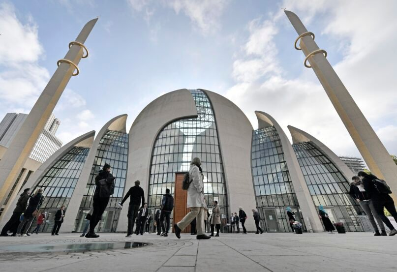 FILE - In this Oct. 3, 2017 file photo people stand outside the central DITIB mosque on the