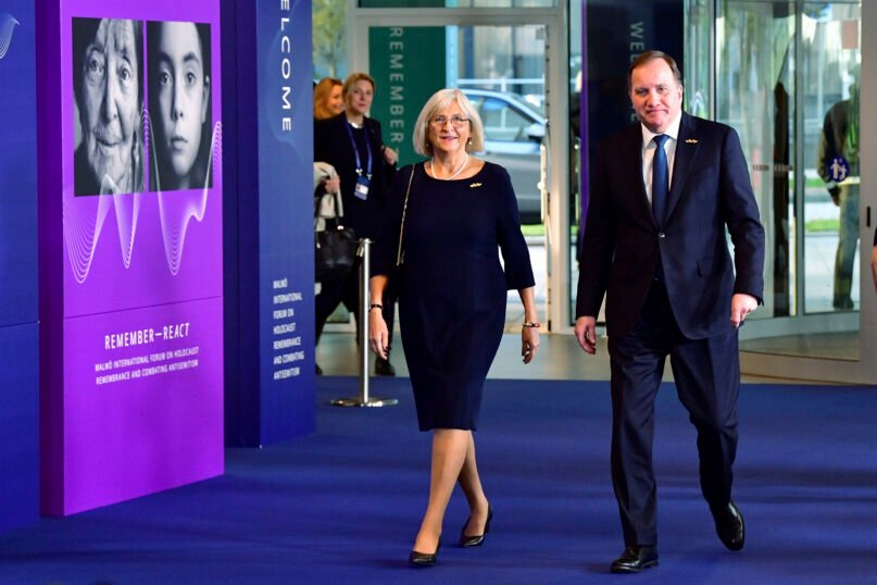 Swedish Prime Minister Stefan Lofven, right, and his wife Ulla arrive at the Malmoe International Forum on Holocaust Remembrance and Combating Antisemitism in Malmoe, Sweden, Wednesday, Oct. 13, 2021.  (Jonas Ekstroemer/TT via AP)