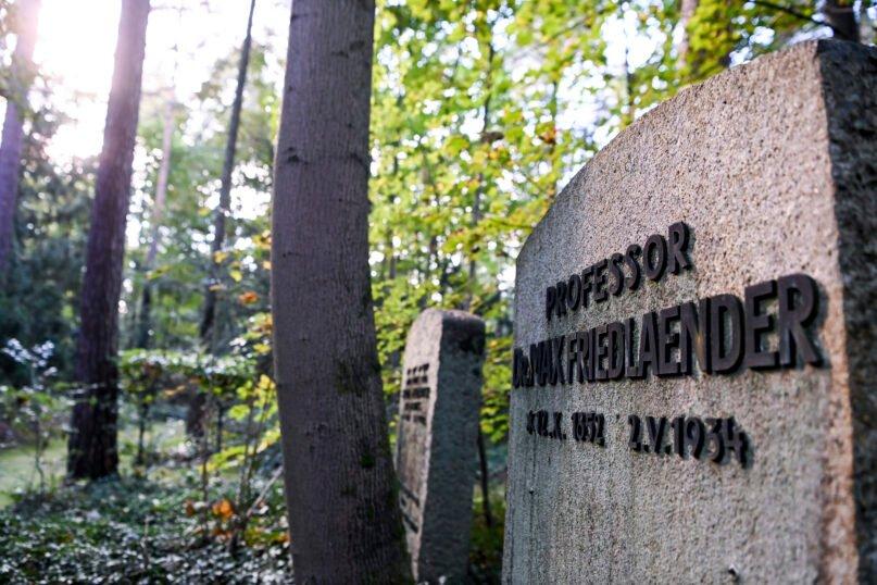 This Oct. 12, 2021, photo shows the grave of Max Friedlaender, a musicologist of Jewish faith at the Suedwestkirchhof Stahnsdorf, Germany. The German government's top official against antisemitism on Wednesday criticized the burial of a Holocaust denier on the former gravesite of a known Jewish musicologist. (Jens Kalaene/dpa via AP)