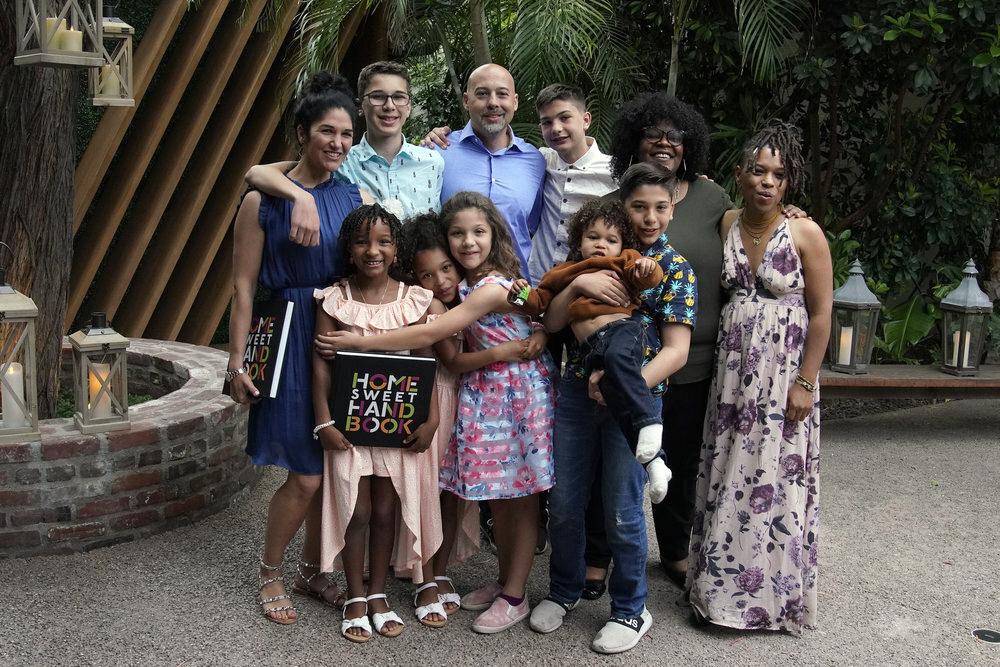 """Home Sweet Home"" families pose together. (clockwise) Maria, Demetri, Nick, Luke, Ynidia, Ania, Leoniads, Zyaire, Katina, Soleil, Sanaiya. Photo by Casey Durkin/NBC"
