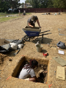 Colonial Williamsburg Archaeological Field Technicians DéShondra Dandridge, bottom, and Victoria Gum at the excavation site of First Baptist Church's original permanent location on South Nassau Street, Sept. 23, 2020. A partnership led by First Baptist Church and Colonial Williamsburg has resumed archaeological investigation of the site, which last took place in 1957. Photo courtesy of Colonial Williamsburg