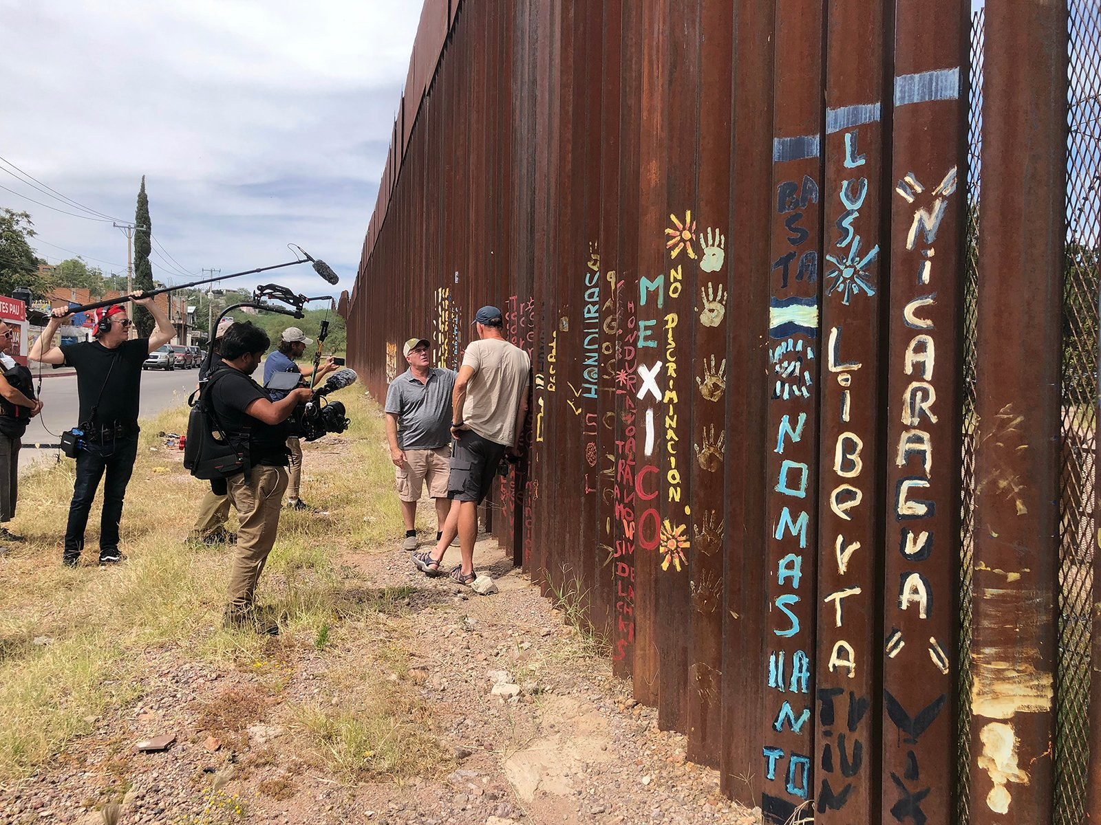 An interview by We The People Ride is conducted along the border fence on the U.S.-Mexico border in late September 2021. Photo courtesy of Vote Common Good