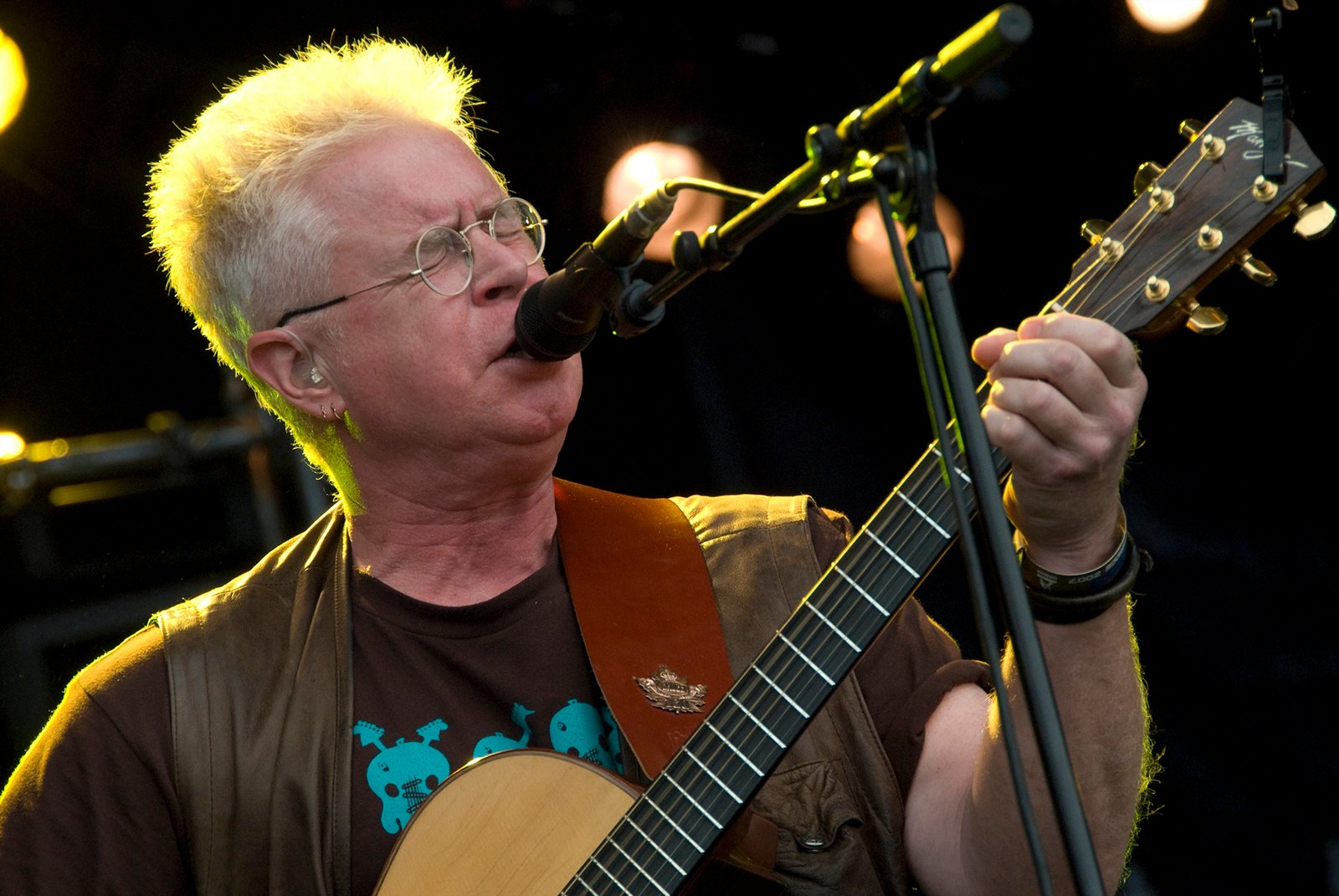 Bruce Cockburn performs at the Cambridge Folk Festival in July 2007. Photo by Bryan Ledgard/Wikimedia/Creative Commons