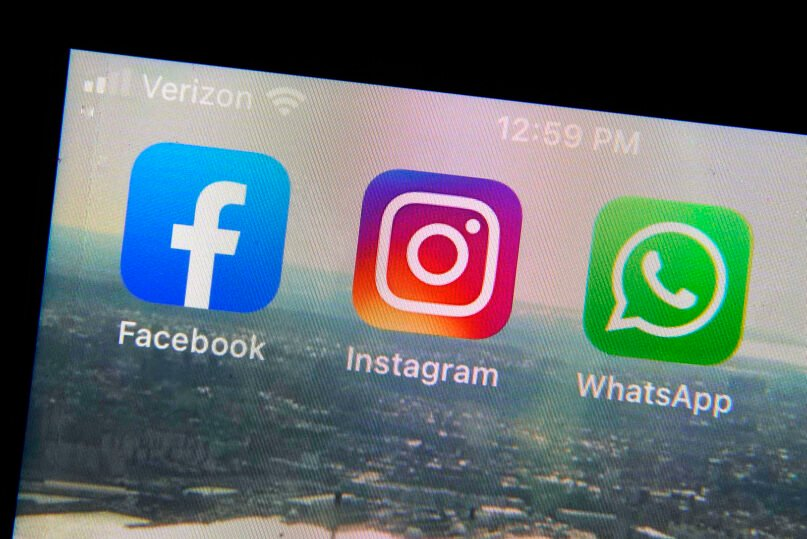 This photo shows the mobile phone app logos for, from left, Facebook, Instagram and WhatsApp in New York, Oct. 5, 2021. The six-hour outage experienced by the three apps was a headache for many casual users but far more serious for the millions of people worldwide who rely on the social media sites to run their businesses or communicate with relatives, fellow parents, teachers or neighbors. (AP Photo/Richard Drew)