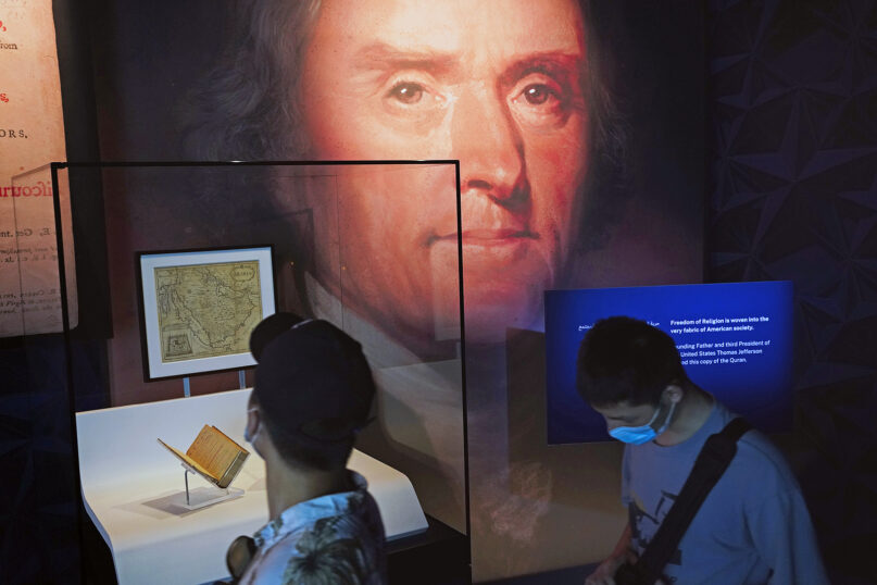 Former American President Thomas Jefferson's Quran, left, which has been used by American politicians at swearing-in ceremonies, sits on display at the U.S. pavilion at the Expo 2020 in Dubai, United Arab Emirates, Friday, Oct. 1, 2021. After eight years of planning and billions of dollars in spending, the Middle East's first ever World Fair opened on Friday in Dubai, with hopes the months-long extravaganza draws both visitors and global attention to this desert-turned-dreamscape. (AP Photo/Jon Gambrell)