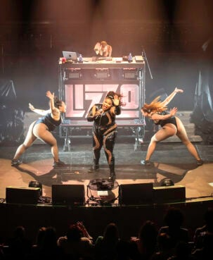 Lizzo, center, performs at the Palace Theatre in St. Paul, Minnesota, May 14, 2018. Photo Andy Witchger/Wikipedia/Creative Commons